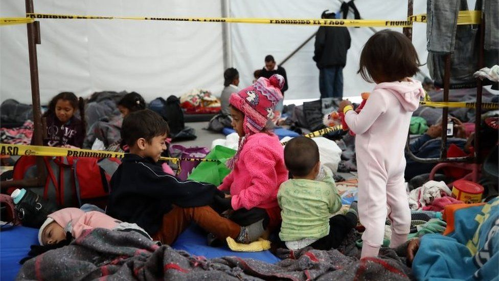 Children rest in the sports stadium-turned-shelter in Mexico City