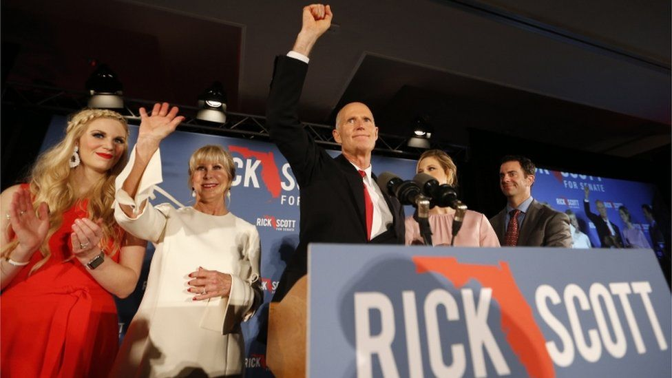 Republican U.S. Senate candidate Rick Scott steps up to the stage with his wife Ann at his midterm election night party
