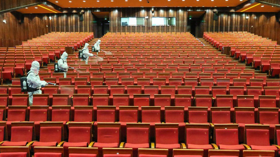 Disinfectant spraying at a cinema as it prepares to reopen in Yantai in China's eastern Shandong province.