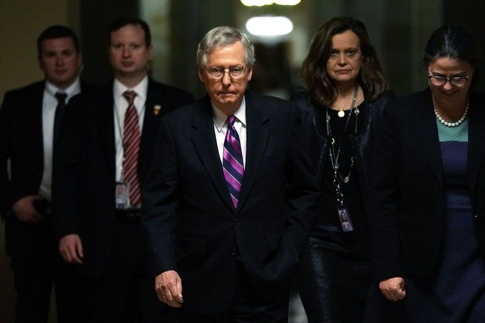 Republican Senate Leader Mitch McConnell walks to the floor after the bill's passage