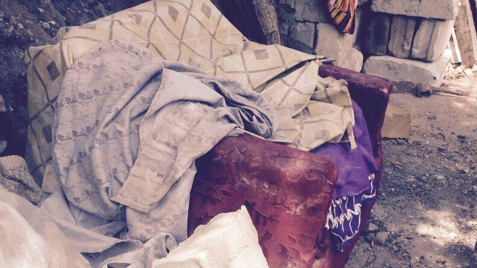 A sofa at a demolition site in Dar es Salaam, Tanzania