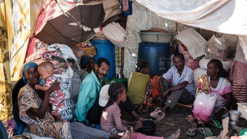 A family of Ethiopian refugees who fled the Tigray conflict rests in a makeshift shelter at the Border Reception Centre in Hamdayet, eastern Sudan, on December 8, 2020