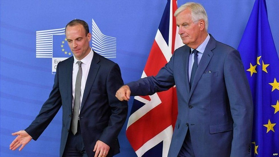 Dominic Raab (left) and Michel Barnier