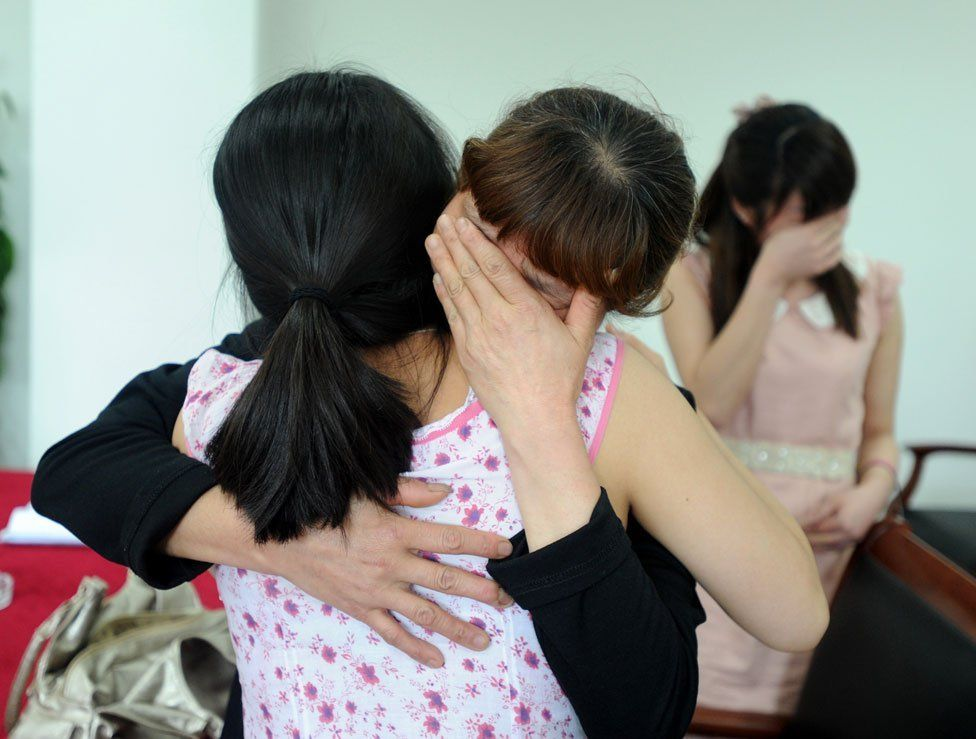Jenna embraces a woman who relinquished her child