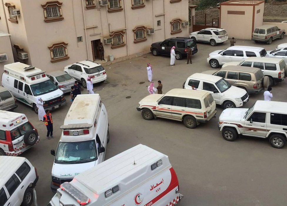 Ambulances gathered outside the building where shooting reportedly took place