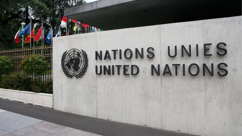 The UN sign outside the United Nations Office in Geneva