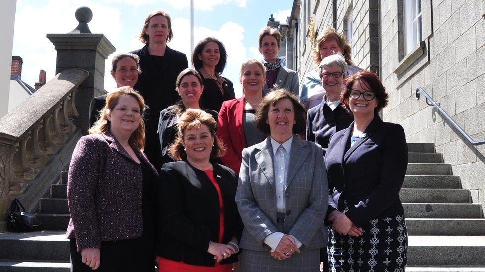 12 female Guernsey deputies.
