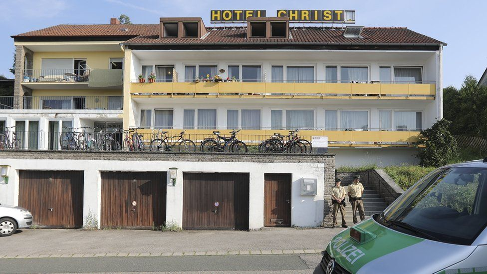 Police guard the hotel where the Ansbach bomber lived, 25 July