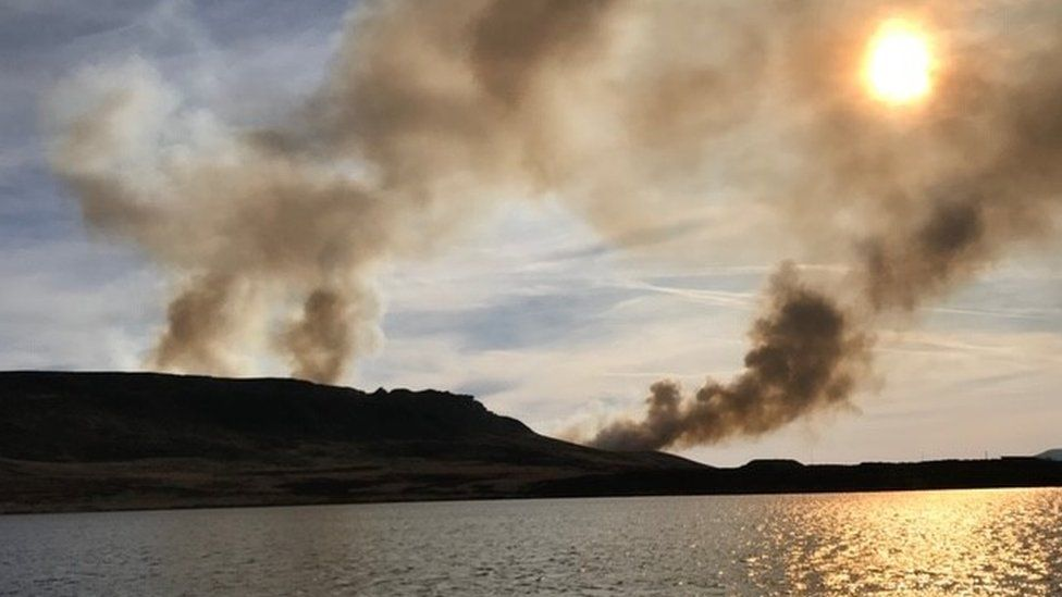 Smoke rising above the reservoir