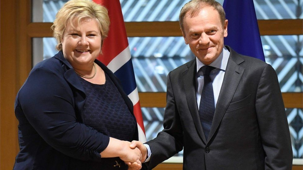 Norway's Prime Minister Erna Solberg and Donald Tusk
