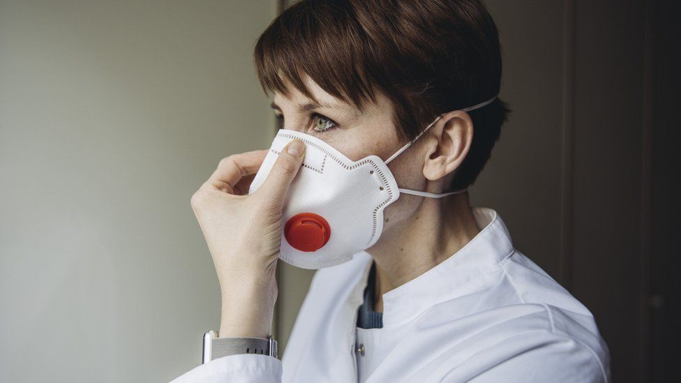 A woman wearing an FFP3 mask