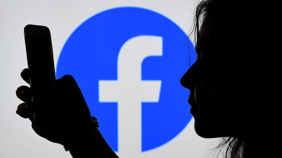 A woman looks at facebook