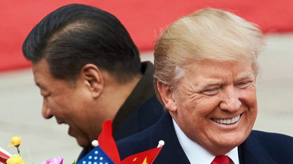 China's President Xi Jinping (L) and US President Donald Trump during a meeting outside the Great Hall of the People in Beijing. Artyom Ivanov/TASS