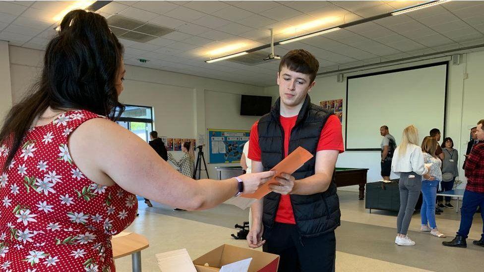 Student receives results at Birchwood Community High School Warrington