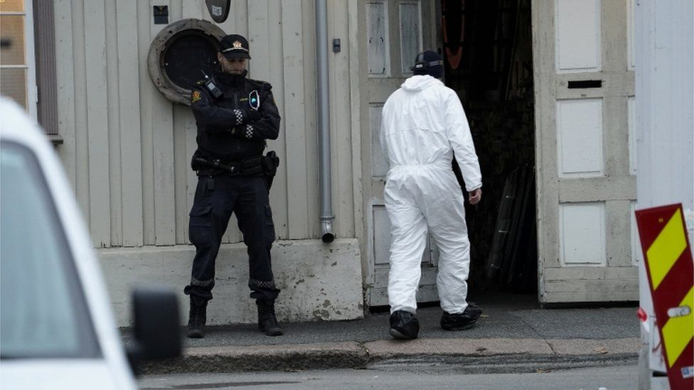 A police technician enters a building after a deadly attack in Kongsberg