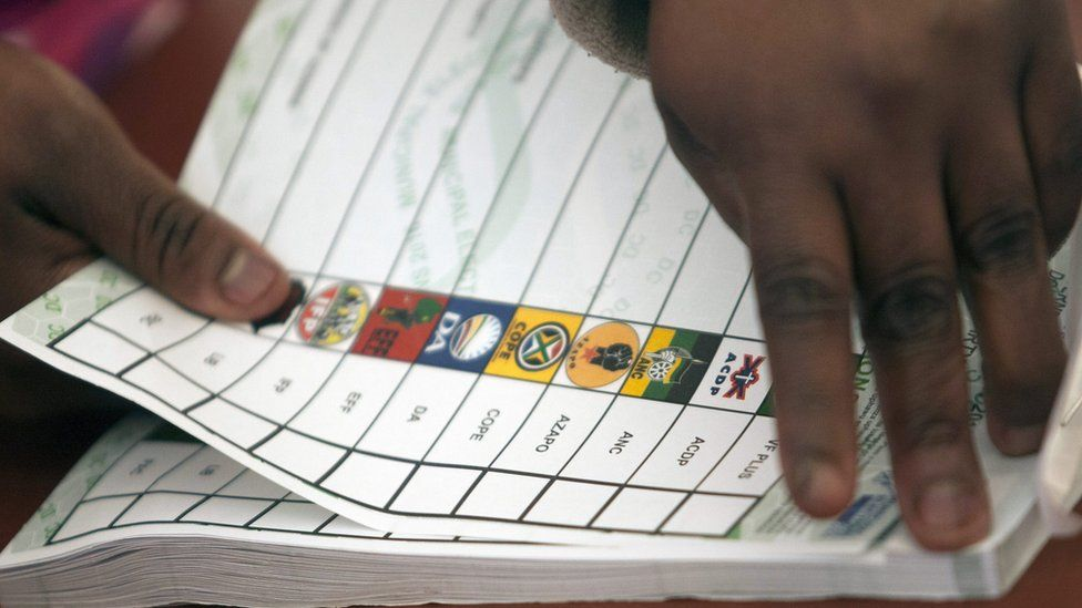 Election Commission worker tears ballot paper at voting station in Meyerton, Midvaal Municipality, south of Johannesburg, South Africa, 3 August 2016