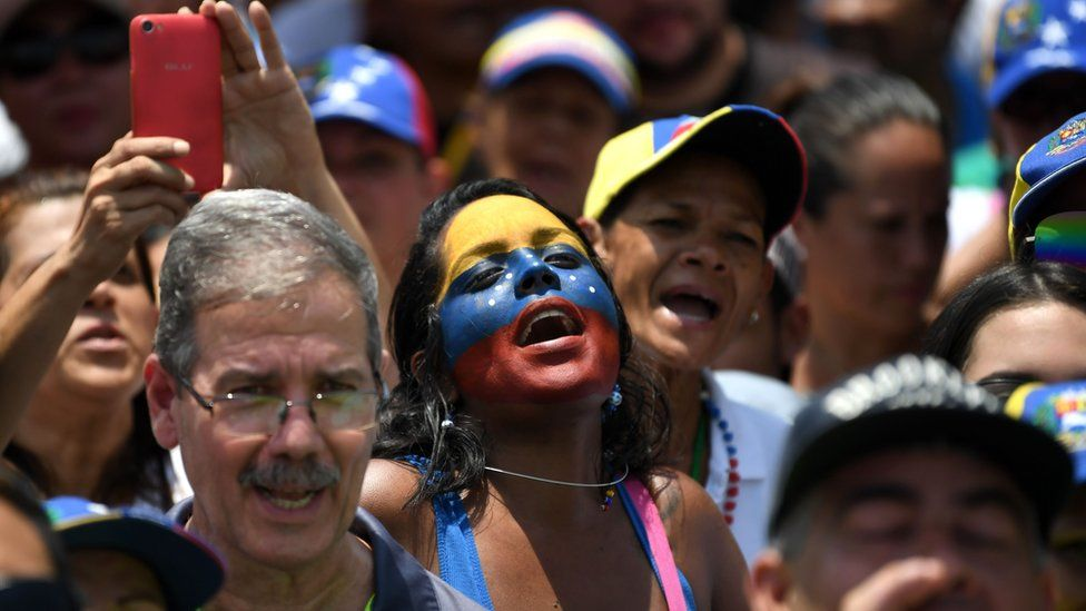 Supporters of Venezuelan opposition leader and self-declared president Juan Guaido attend a rally in Guatire, Miranda state, Venezuela on 18 May