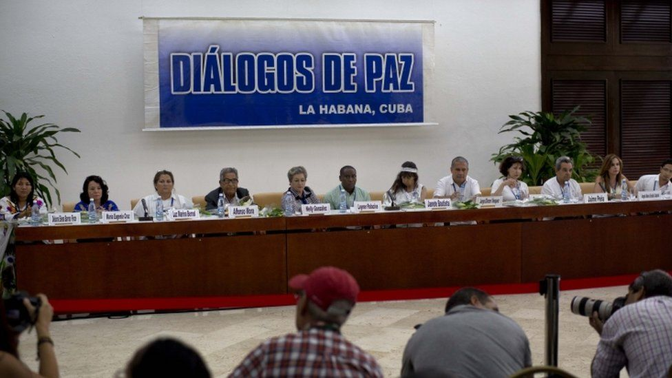"FILE - In this Aug. 16, 2014 file photo, victims of the Colombian armed conflict give a press conference after a meeting with the peace negotiation teams of the Revolutionary Armed Forces of Colombia (FARC) and Colombia""s government on the sidelines of peace talks in Havana, Cuba. Declaring that ""peace is near,"" Colombia""s President Juan"