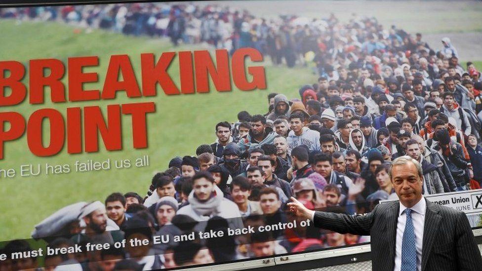 Nigel Farage standing in front of poster during EU referendum