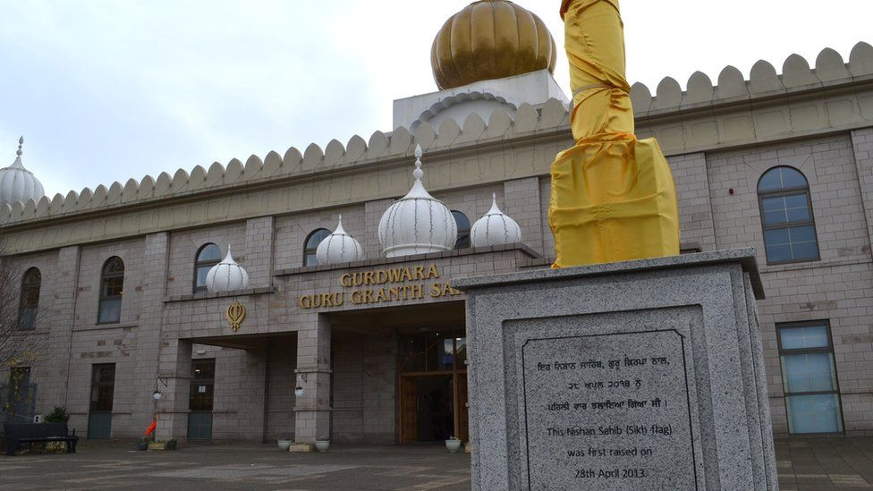 A view of the Glasgow Gurdwara and flag pole outside its entrance