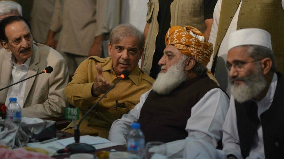 Pakistani opposition leader Maulana Fazalur Rehman (2nd R) and Shahbaz Sharif (2nd L), younger brother of Nawaz Sharif, attend an All Parties Conference in Islamabad on July 27, 2018