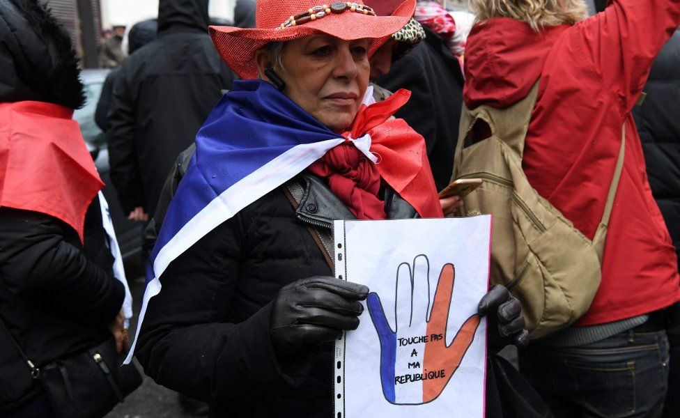 Red scarves - opponents of the yellow vests - take part in a rally in Paris, January 27, 2019