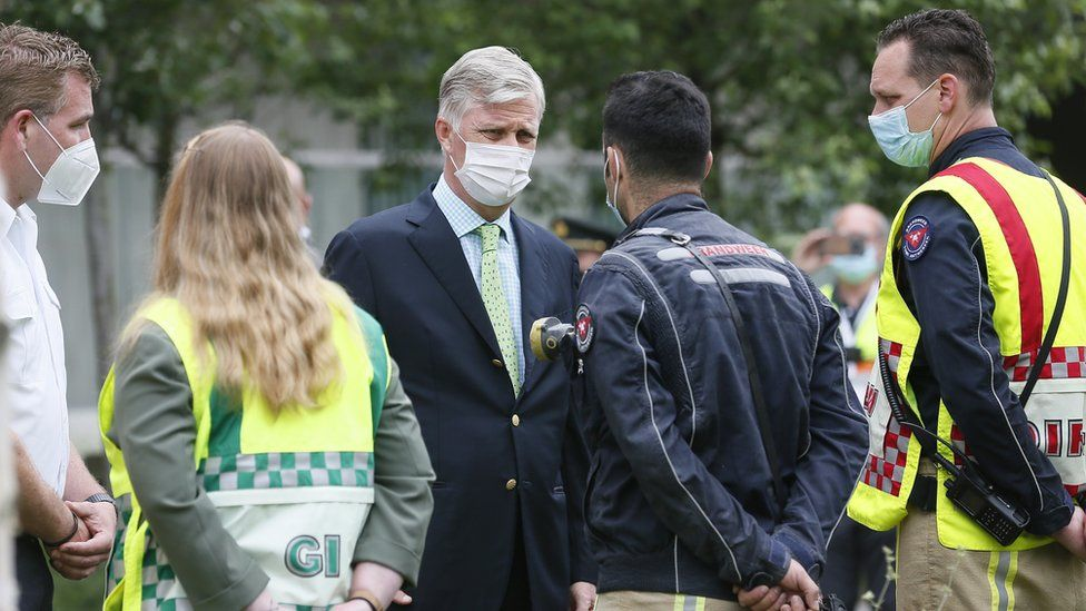 King Philippe of Belgium speaks with rescue workers on site