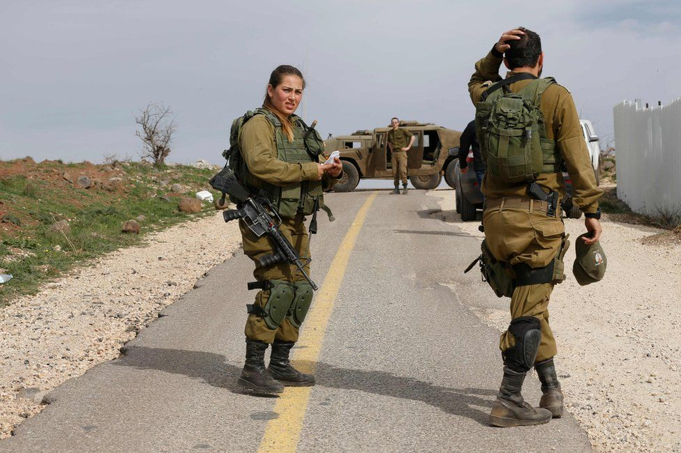 Israeli soldiers block a road in the Israeli-annexed Golan Heights, 10 February 2018