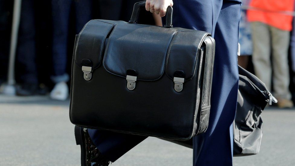 Obama aide carries nuclear briefcase