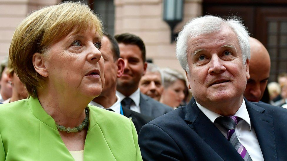 Angela Merkel and German Interior Minister Horst Seehofer attend a Berlin event on the occasion of the World Refugee Day on June 20, 2018
