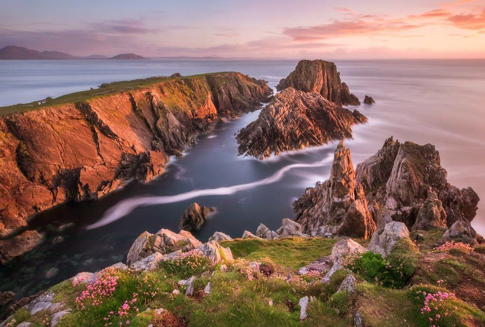 Sunset over the jagged rocks at Malin Head in County Donegal