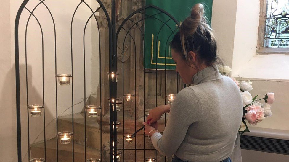Candle being lit at church