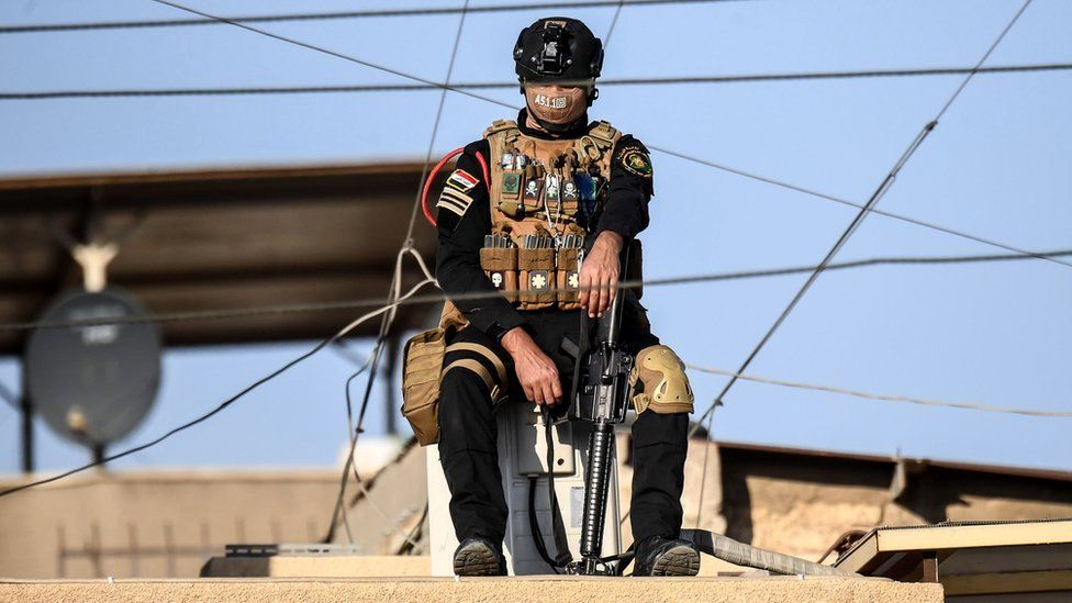 A member of the Iraqi special operations forces on guard near Baghdad's Saint Joseph Cathedral ahead of a mass celebrated by Pope Francis, 6 March 2021