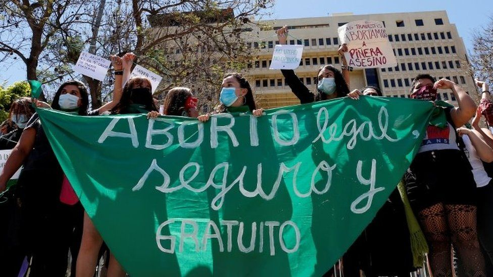 Pro-choice activists shout slogans outside Congress where lawmakers will begin to discuss a bill that decriminalises abortion until the 14th week of gestation, in Valparaiso, Chile January 13, 2021.