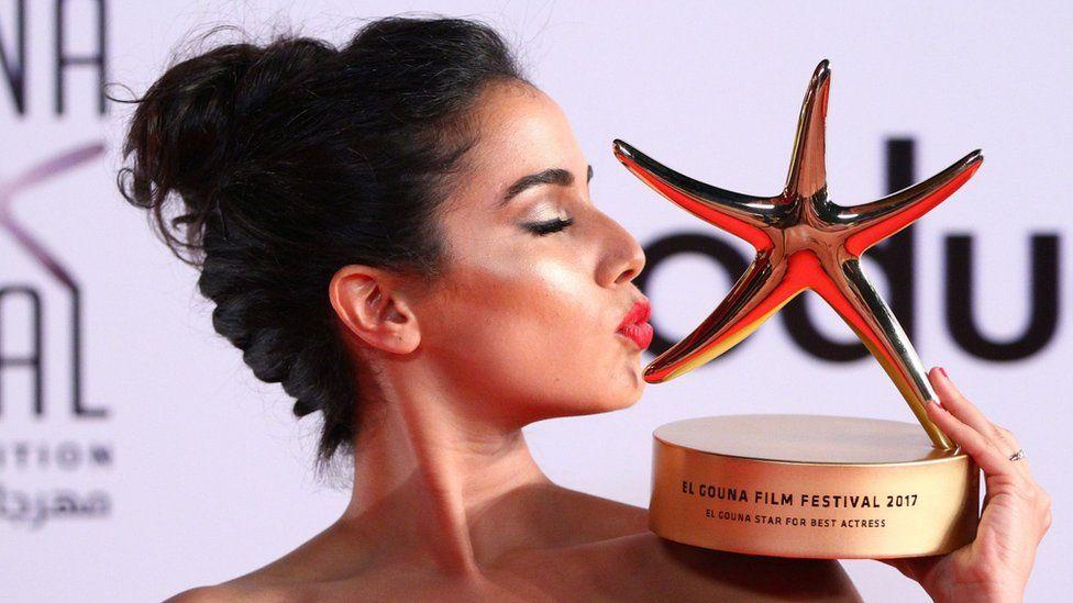 Moroccan actress Nadia Kounda kisses her award for her award for best actress, El-Gouna, Egypt - Friday 29 September 2017