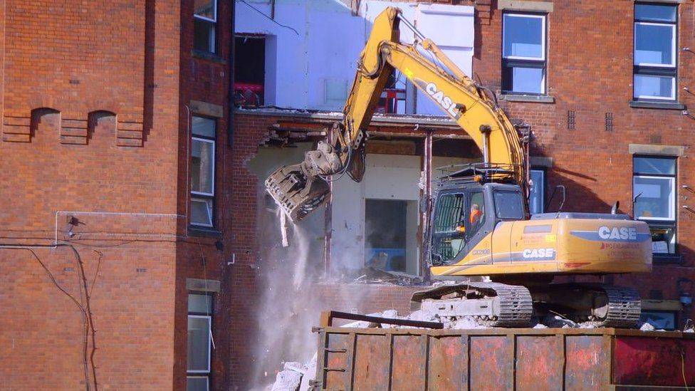 Demolishing the hospital