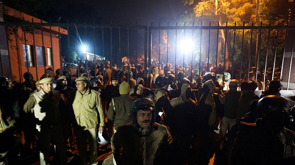 Police gather outside a gate of the Jawaharlal Nehru University (JNU) in Delhi on January 5, 2020