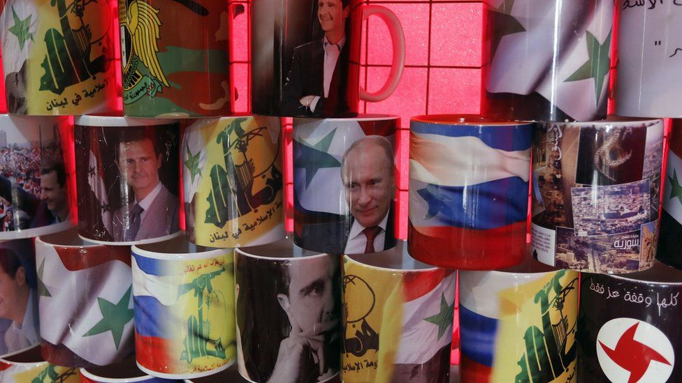 Mugs displaying portraits of Syrian President Bashar al-Assad and his Russian counterpart Vladimir Putin are seen in central Damascus on April 7, 2017