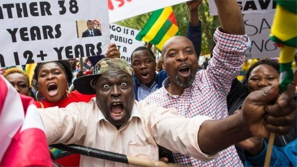 Abdou Razak (C) of Togo demonstrates with others against President Faure Gnassingbé in Dag Hammarskjold Plaza outside the UN in New York on September19, 2017