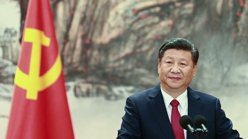 Xi Jinping at the podium during the unveiling of the Communist Party's new Politburo Standing Committee