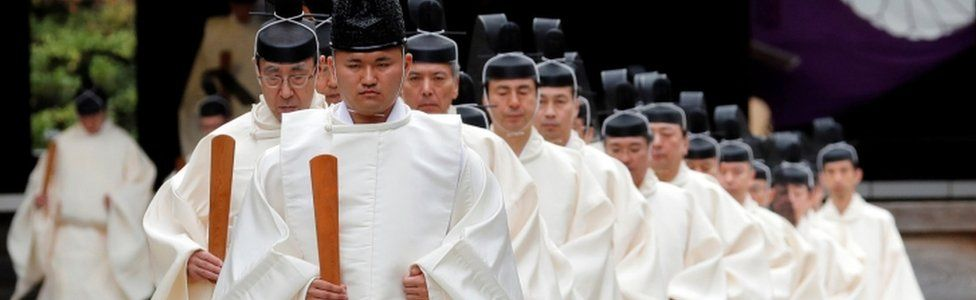 Shinto priests attend a ritual during an autumn festival at the Yasukuni Shrine in Tokyo