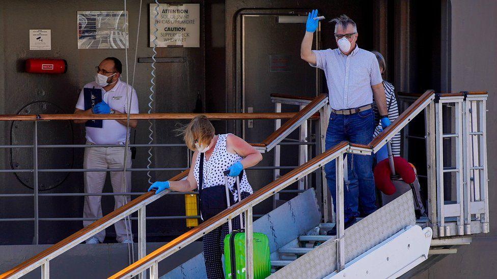 Passengers leaving the Le Boreal cruise ship in Rio de Janeiro on 26 March