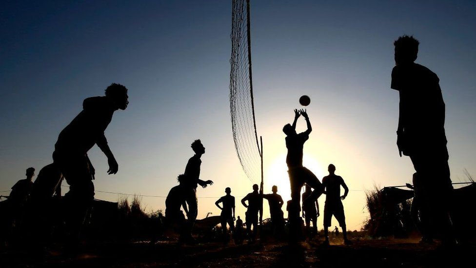 Ethiopian refugees who fled fighting in Tigray province play volleyball at the Um Raquba camp in Sudan's eastern Gedaref province, on November 21, 2020.
