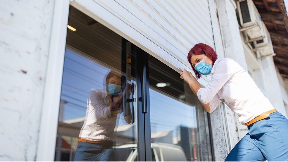 Young worker shutting up premises