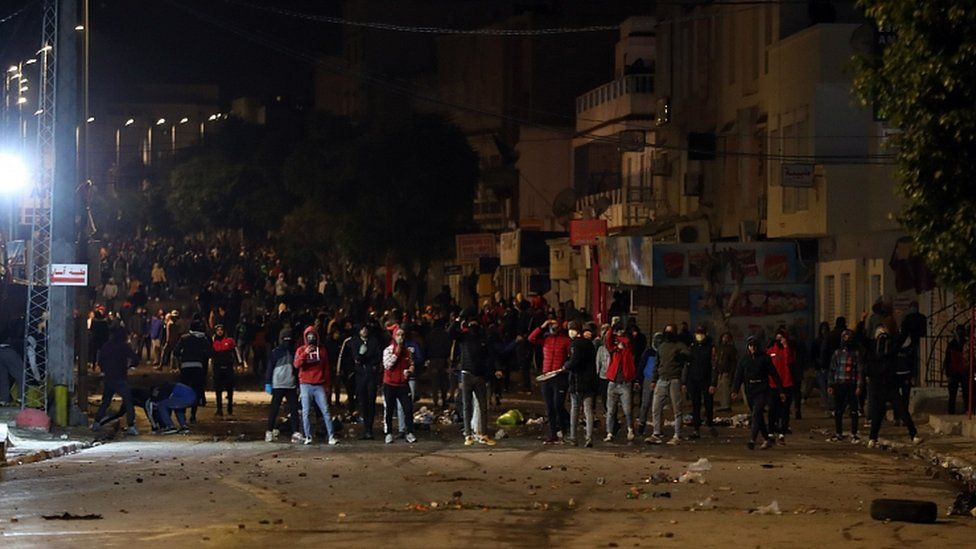 Demonstrators clash with security forces during anti-government protests in Tunis, Tunisia, 18 January 2021.