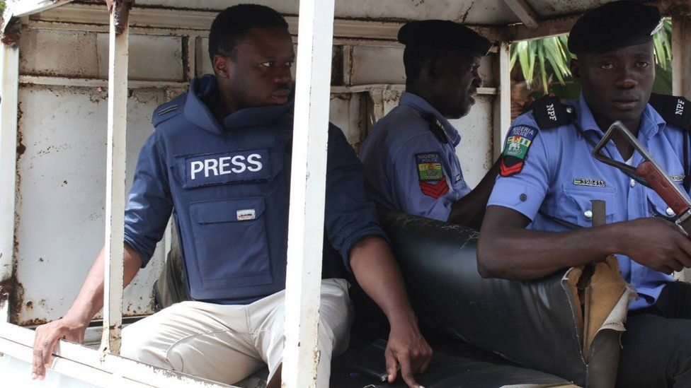 Tomi Oladipo in a car with Nigerian security forces