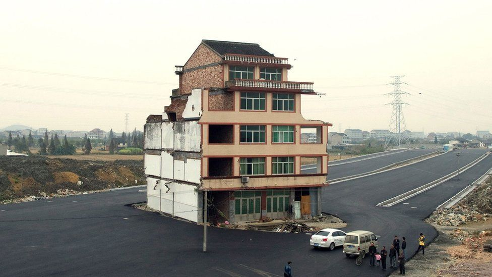House in the middle of a newly-built road in Wenling, in eastern China's Zhejiang province