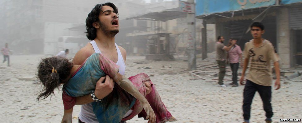Grieving Syrian man and injured girl