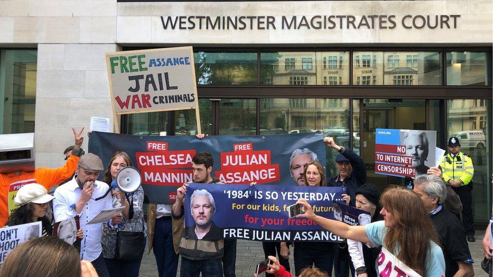 Julian Assange supporters outside Westminster Magistrates Court where the WikiLeaks founder is expected to appear via videolink as he continues to fight against extradition to the United States over allegations he conspired to break into a classified Pentagon computer.