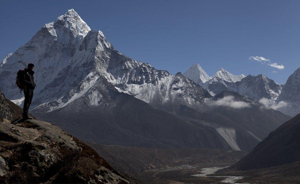 Trekker above Pheriche valley, Nepal